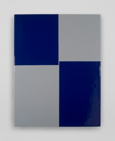 An enamel painting with grey and navy blue quadrants