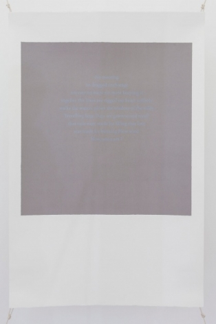 A photograph of a silkscreen on paper. The shape resembles a polaroid (white space on the bottom and a white frame around a central grey space). The grey space in the middle of the work has text in faint blue letters, illegible from a distance.