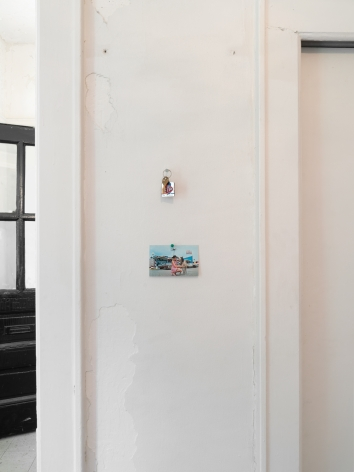 A photograph of two items installed to the right of the front door in the installation