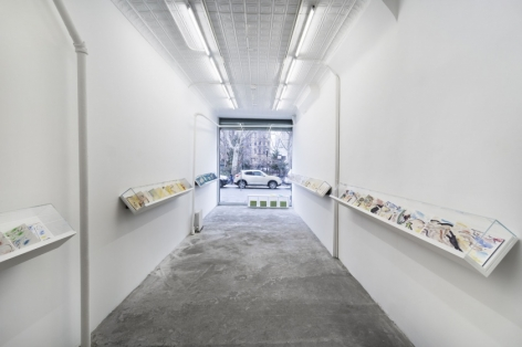A photograph of the 124 Forsyth gallery, with 5 vitrines containing leporellos by Etel Adnan. At the far end of the photograph is the front window/entrance of the gallery.