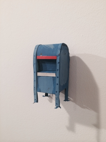 A blue mailbox made out of paper