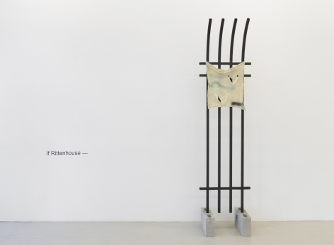 """installation view of the exhibition showing the title of the show in black vinyl letters that read """"If Rittenthouse--"""" and a sculpture of a fence with pale yellow fabric handing from the top that is rendered in glass"""
