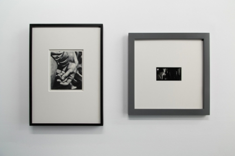 A photograph of 2 black and white photographs, framed.