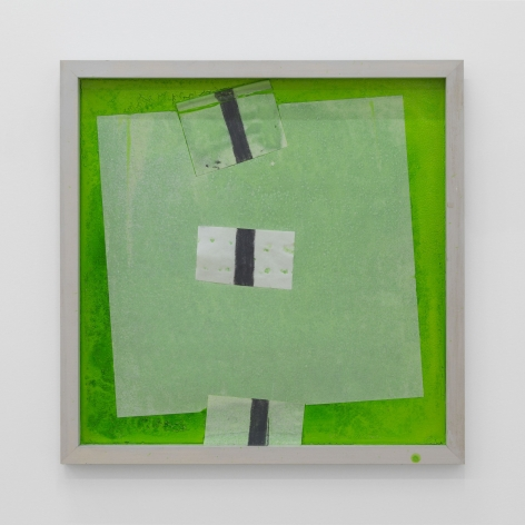 A photograph of a framed work that is made predominantly of green, transparent tracing paper, and black paint. The pieces of tracing paper are square (large), and 3 small rectangles with a black line running vertically through the shape.