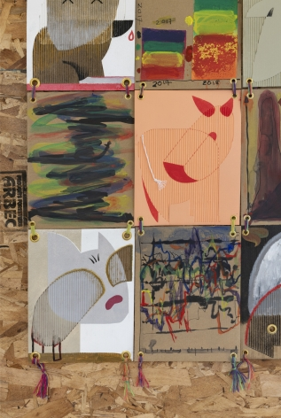 paintings on cardboard showing abstracted graphs and puppy images
