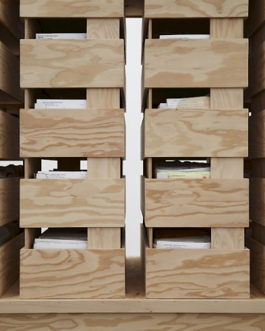 A photograph of a detail of the natural wood structure. This is a close-up of the plywood boxes that enclosed correspondence and letters.