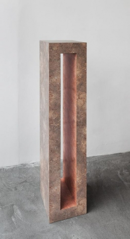 A photograph of a tall, rectangular shape with an opening through the center.