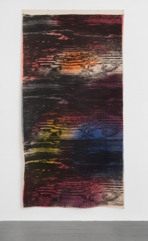 A photograph of the mixed media artwork hanging on the wall like a tapestry. There are abstract black lines upon it that ebb and flow like static on a television. The predominantly colors otherwise in the artwork are pink, orange, yellow, blue, and white.