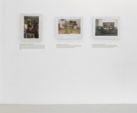 An installation view of 3 photographs by Jiri Skala of factory machines