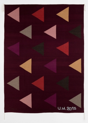 A purple, wool rug with 6 rows of equilateral triangles, in varied pink, red, orange, and grey tones.