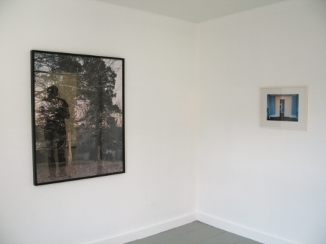 A photograph of 2 photographs on 2 walls, one large on the left and the other smaller