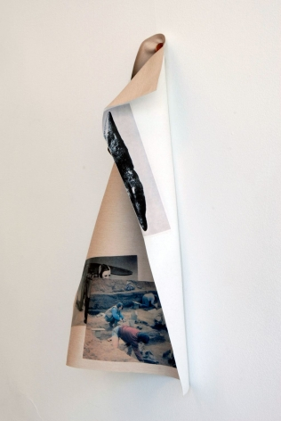 A photograph of the artwork, folding over itself under the weight of gravity