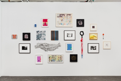 A photograph of the salon wall, featuring 21 artworks