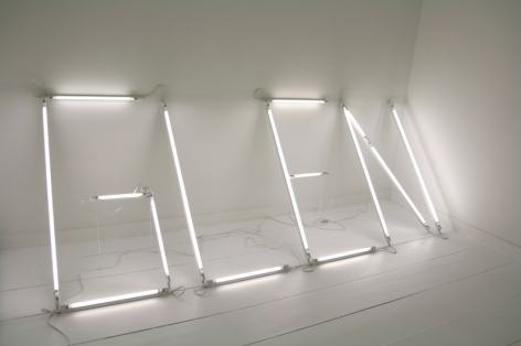 """A view of """"G-L-E-N"""" written in white neon tubes, very rudimentary"""