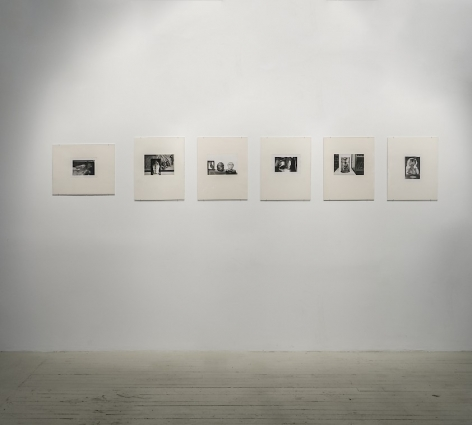 6 Hervé Guibert black and white photographs on cream mattes in a straight line on a single wall.