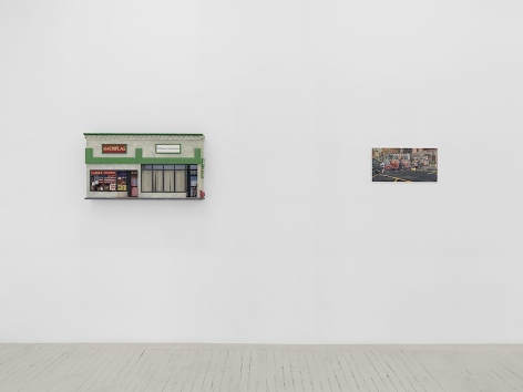 An installation image of 1 sculpture and 1 painting by Nicholas Buffon hung on the wall