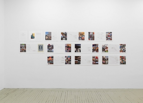 An assembly of 9 double-page spreads, 2 single-page spreads, and one cover page. Each is installed on a white wall in the gallery, in 3 rows.