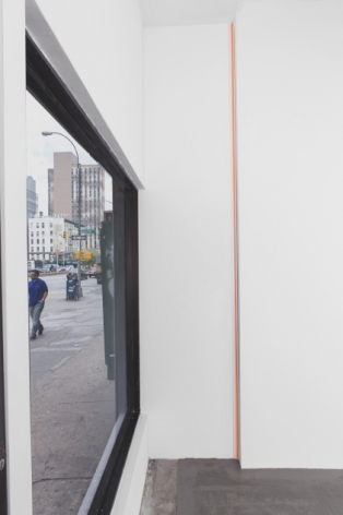 "A photograph of the front window at left of the gallery and a grosgrain ribbon piece in orange (""creamsicle"") installed in the front corner of the gallery."