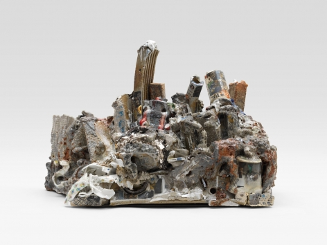 A ceramic sculpture made up of varied shapes and forms, decals, lusters, and pipes.