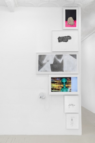 A column of drawings, paintings, and a video work, installed at the edge of a wall that leads into another room. All works are justified to the edge of the wall.