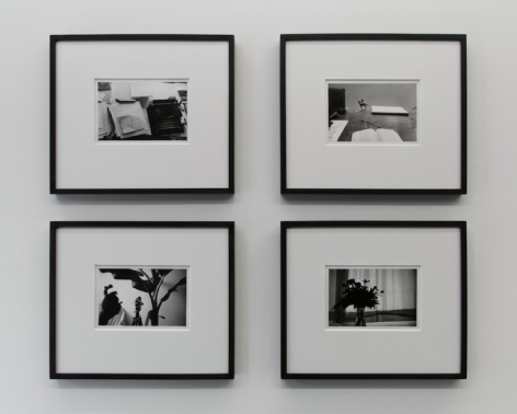 A photograph of 4 black and white images, framed in black, in a square formation