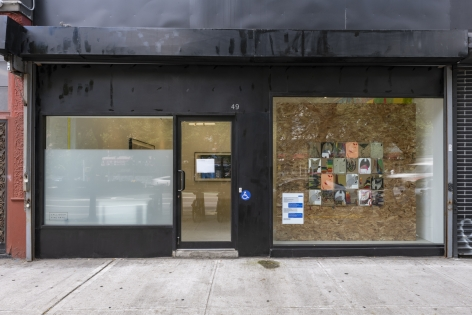 Front view of the storefront window with the same installation