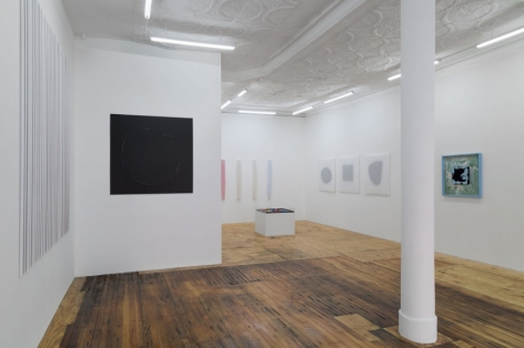 A photograph of the gallery install looking toward the back office space