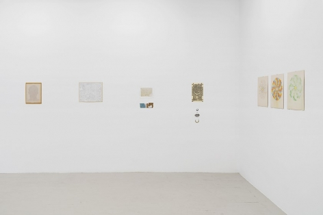 An installation image of 6 mixed media works on paper installed on the wall with no frames