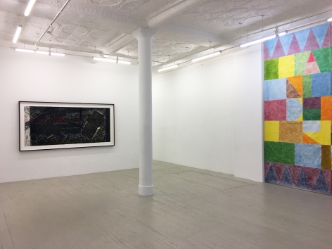 Installation view of Kahlil Robert Irving's collograph print and a portion of Colter Jacobsen's artwork