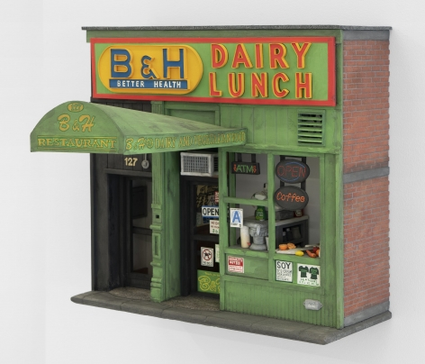 A sculpture hung on the wall that recreates B&H Dairy Luncheonette in Manhattan, and it's accompanying doorway with all details (counter, signage, vents) made of foam or paper