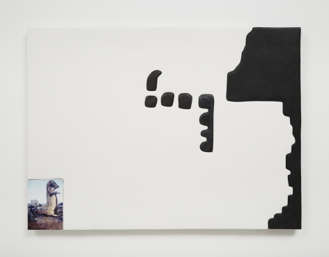 A work that is predominantly white, with abstract black shapes on the right side. At bottom-left corner there is a photograph of an inflated dinosaur