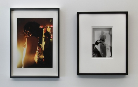 A photograph of 2 images in a row, framed in black. The left image is in color, the right is black and white