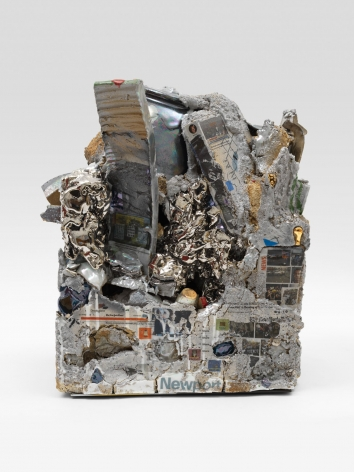 A ceramic sculpture, composed like a block of stone, that includes a multitude of lusters, decals, and shapes, layered upon one another.