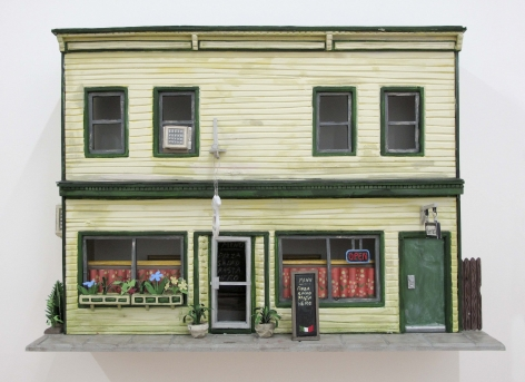 A photograph of the facade of the building that housed Callicoon Fine Arts in Callicoon, NY, made from foam core and paper. It is a yellow building with green trim and doors. There is an Italian restaurant on the first floor.