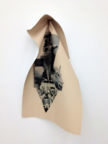 A photocollage held by a hidden penny to the wall, folded and wilting