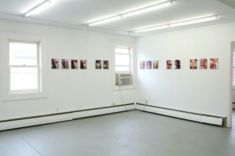 A photograph of 14 images over 2 walls around a corner. There are 2 windows included at left