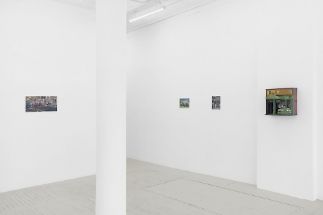 An installation image of 3 paintings and 1 sculpture by Nicholas Buffon hung on the wall