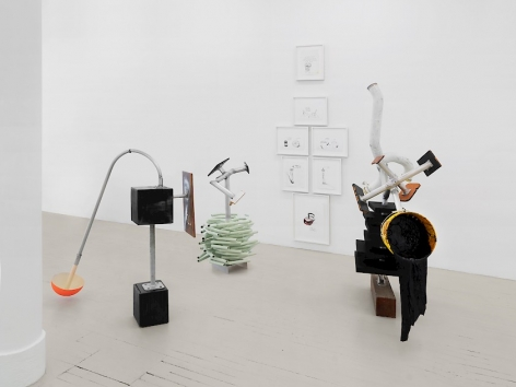 """A cluster of 4 sculptures made of mixed media including """"Forms-To-Come"""" and """"User"""""""