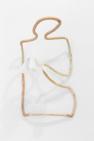 A plywood sculpture that is meant to look like a single carved line. The line describes a silhouette of a figure, installed on the wall, with a tissue in its hand.
