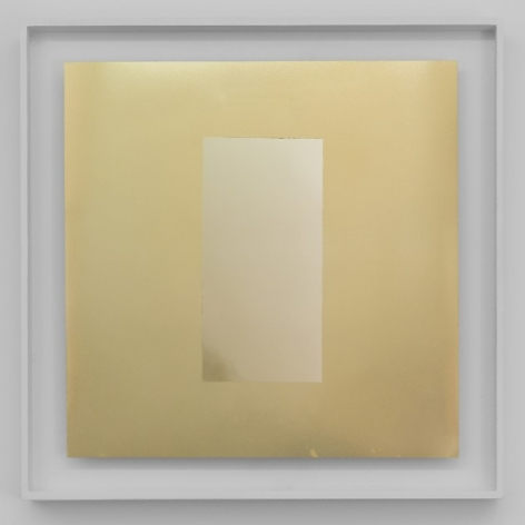 A square artwork that has a rectangle centrally situated on a gold ground. All surfaces are highly reflective. The work is framed in white.