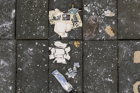 A detail of printed decals applied to Kahlil Robert Irving's large floor sculpture: a squished aluminum can made of ceramics, shards of ceramic vases, and ceramic clam shells