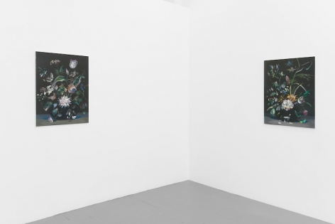 Two paintings mirroring each other on the corner of the room. They resemble one another.