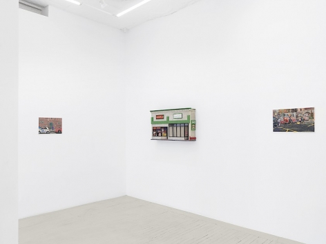 An installation image of 2 paintings and 1 sculpture hung on the wall by Nicholas Buffon hung