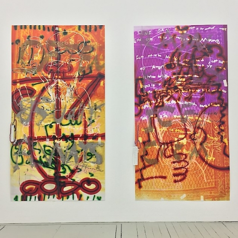 A photograph of two large vertical artworks. On the left the canvas is yellow at the bottom and more orange near the top. There are lines in silver, green, and red intersected with black. The work on the right has an orange and purple background with silver, red, and yellow lines over and throughout.