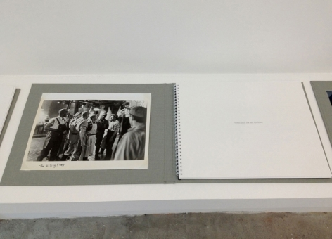 A photograph of the artwork at an angle, open to the title page.