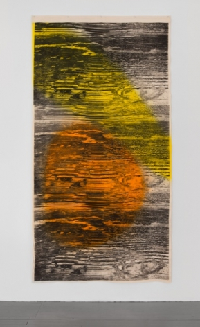 A photograph of the mixed media artwork hanging on the wall like a tapestry. There are abstract black lines upon it that ebb and flow like static on a television. The predominantly colors otherwise in the artwork are yellow, orange, and white.