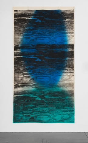 A photograph of the mixed media artwork hanging on the wall like a tapestry. There are abstract black lines upon it that ebb and flow like static on a television. The predominantly colors otherwise in the artwork are blue, teal, and white.