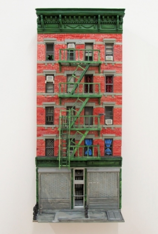 A 3d sculpture of an entire building in New York City. There is a fire escape that is green running up 4 stories. There is a ground floor commercial business with the shutters down.