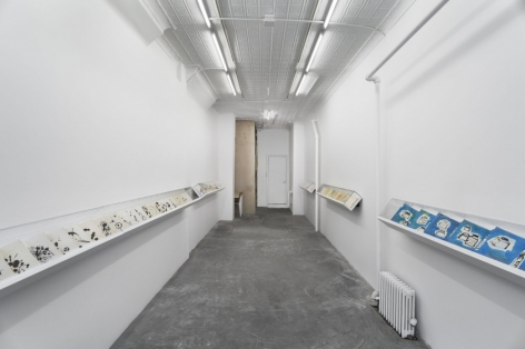 A photograph of the 124 Forsyth gallery, with 5 vitrines containing leporellos by Etel Adnan