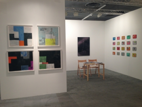 A view of the booth with 4 Sadie Benning works on the exterior, and a desk in the center of the booth